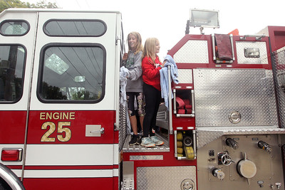 Candace H. Johnson-For Shaw Media Stanton's Amelia Szopinski and Jenna Russo, both 12, 7th graders from Fox Lake, wipe down fire engine 25 after it was washed at the Fox Lake Fire Protection District Station #2 during Fox Lake Grade School District 114's 5th Annual Day of Service. (9/27/19)