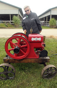 Candace H. Johnson-For Shaw Media Peg Pfeiffer, of Rolling Meadows talks about the Economy gasoline engine she had on display which was featured in the Sears catalog in 1927 for $49.50 if you paid cash during the Lake County Farm Heritage Association's Farm Heritage & Harvest Festival at the Lake County Fairgrounds in Grayslake.  (9/28/19)
