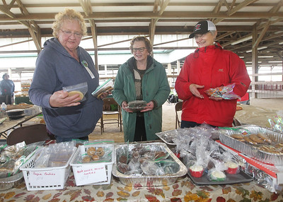 Candace H. Johnson-For Shaw Media Linda Werhane, of Grayslake, Jan Stimson, of Waukegan and Janet Scales, of Gurnee help with the Bake Sale during the Lake County Farm Heritage Association's Farm Heritage & Harvest Festival at the Lake County Fairgrounds in Grayslake.  (9/28/19)