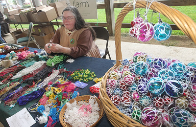 Candace H. Johnson-For Shaw Media Gail Mathews-Bailey, of Round Lake Beach with Space Shuttle Crafts, demonstrates tatting as she makes a snowflake during the Lake County Farm Heritage Association's Farm Heritage & Harvest Festival at the Lake County Fairgrounds in Grayslake.  (9/28/19)