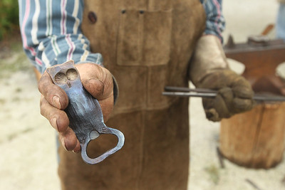Candace H. Johnson-For Shaw Media Jim Handzel, of Palatine shows an owl bottle opener he made from steel as he demonstrates blacksmithing during the Lake County Farm Heritage Association's Farm Heritage & Harvest Festival at the Lake County Fairgrounds in Grayslake.  (9/28/19)