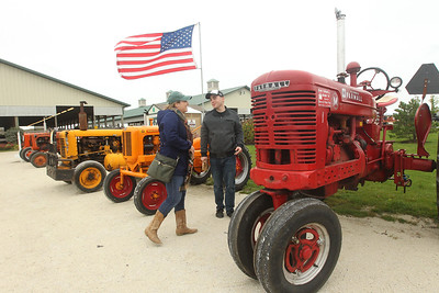 Candace H. Johnson-For Shaw Media Geena Anselmo, of Gurnee and her brother, Curtis, check out the vintage tractors on display during the Lake County Farm Heritage Association's Farm Heritage & Harvest Festival at the Lake County Fairgrounds in Grayslake.  (9/28/19)