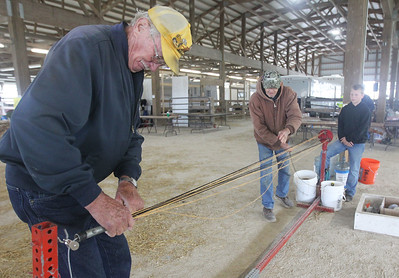 Candace H. Johnson-For Shaw Media John Grandfield, of Antioch and John Lahr, of Volo help Christian Sebring, 13, of Marengo make a rope with a 1940's rope maker during the Lake County Farm Heritage Association's Farm Heritage & Harvest Festival at the Lake County Fairgrounds in Grayslake.  (9/29/19)