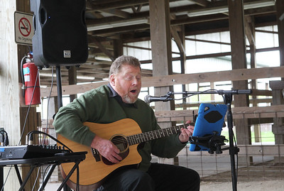 Candace H. Johnson-For Shaw Media Richard Chubb, of Chicago sings a George Strait song as he entertains visitors during the Lake County Farm Heritage Association's Farm Heritage & Harvest Festival at the Lake County Fairgrounds in Grayslake.  (9/28/19)