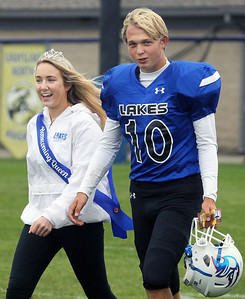 Candace H. Johnson-For Shaw Media Lakes Anna Gipple, of Lindenhurst and Henrik Mamdt, of Lake Villa, both 17, walk on the field after having been introduced to the crowd as the new Homecoming Queen and King during the homecoming varsity football game againt Wauconda at Lakes Community High School in Lake Villa. Mamdt is a foreign exchange student from Norway. (9/28/19)