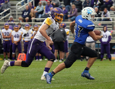 Candace H. Johnson-For Shaw Media Wauconda's Aidan Stephan tries to catch up with Lakes David Garcia as he runs the ball in the second quarter during the homecoming game at Lakes Community High School in Lake Villa. Lakes won 33-7.(9/28/19)