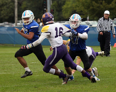 Candace H. Johnson-For Shaw Media Lakes Mark Hunter get some help from his teammate, Jack Lochner, escaping the tackle by Wauconda's Javerius McGuinn (#16) in the second quarter during the homecoming game at Lakes Community High School in Lake Villa. Lakes won 33-7.(9/28/19)