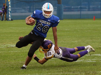 Candace H. Johnson-For Shaw Media Lakes Mark Hunter escapes the tackle by Wauconda's Colin Husko in the second quarter during the homecoming game at Lakes Community High School in Lake Villa. Lakes won 33-7.(9/28/19)