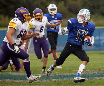 Candace H. Johnson-For Shaw Media Lakes Jack Lochner (#17) keeps away from Wauconda's Jose Casarrubias (#66) as he carries the ball in the fourth quarter during the homecoming game at Lakes Community High School in Lake Villa. Lakes won 33-7.(9/28/19)