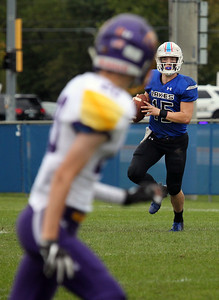 Candace H. Johnson-For Shaw Media Lakes quarterback Christopher Selig looks to pass against Wauconda in the second quarter during the homecoming game at Lakes Community High School in Lake Villa. Lakes won 33-7.(9/28/19)