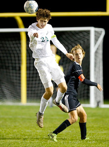 Crystal Lake South Evan Carlson (24) heads the ball against Crystal Lake Central on Tuesday, October 8, 2019, at Crystal Lake Central High School in Crystal Lake, Ill. The Crystal Lake South Gators defeated the Crystal Lake Central Tigers 3-1.
