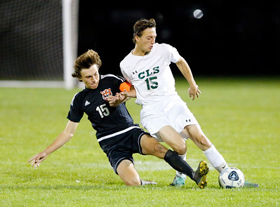 Crystal Lake South William Cummings (15) fights for the ball with Crystal Lake Central Jake Bimbi (15) on Tuesday, October 8, 2019, at Crystal Lake Central High School in Crystal Lake, Ill. The Crystal Lake South Gators defeated the Crystal Lake Central Tigers 3-1.