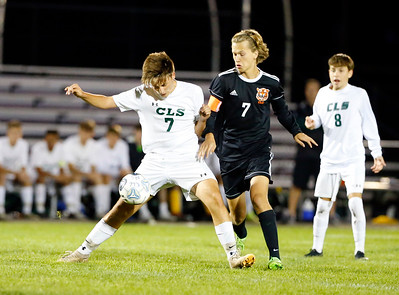 Crystal Lake South Tyler Getzinger (7) fights for a ball with Crystal Lake Central Jake Nelson (7) on Tuesday, October 8, 2019, at Crystal Lake Central High School in Crystal Lake, Ill. The Crystal Lake South Gators defeated the Crystal Lake Central Tigers 3-1.
