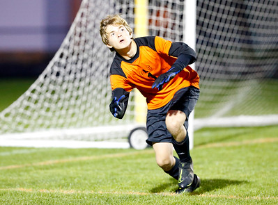 Crystal Lake Central goalkeeper Joseph Moore (1) dives for the ball on Tuesday, October 8, 2019, at Crystal Lake Central High School in Crystal Lake, Ill. The Crystal Lake South Gators defeated the Crystal Lake Central Tigers 3-1.