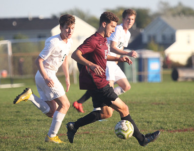 Candace H. Johnson-For Shaw Media Zion-Benton's Zach Paxton gets to the ball ahead of Grayslake Central's Thomas Conlon and Nick Hoffman in the first half at Zion-Benton Township High School in Zion. Zion-Benton won 4-2. (10/8/19)