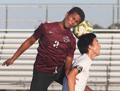 Candace H. Johnson-For Shaw Media Zion-Benton's Denny Matute and Grayslake Central's Owen Aaberg go up for a header in the first half at Zion-Benton Township High School in Zion. Zion-Benton won 4-2. (10/8/19)