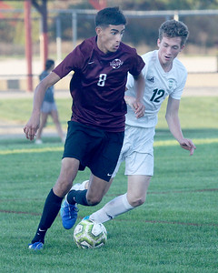 Candace H. Johnson-For Shaw Media Zion-Benton's Osmar Barajas battles for control with Grayslake Central's Nick Hoffman in the second half at Zion-Benton Township High School in Zion. Zion-Benton won 4-2. (10/8/19)