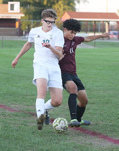 Candace H. Johnson-For Shaw Media Grayslake Central's Drew Kosikowski battles for control with Zion-Benton's Isaac Sotelo as the ball goes out of bounds in the second half at Zion-Benton Township High School in Zion. Zion-Benton won 4-2. (10/8/19)