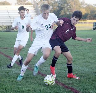 Candace H. Johnson-For Shaw Media Grayslake Central's Damian Makowski (#24) battles for control with Zion-Benton's Miguel Solis in the second half at Zion-Benton Township High School in Zion. Zion-Benton won 4-2. Grayslake Central's Christian Hinestrosa (#5) stayed close by. (10/8/19)