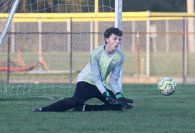 Candace H. Johnson-For Shaw Media Grayslake Central's Jonathan Piggott stops a shot on goal by Zion-Benton in the second half at Zion-Benton Township High School in Zion. Zion-Benton won 4-2. (10/8/19)