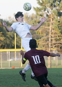 Candace H. Johnson-For Shaw Media Grayslake Central's Tyler Armstrong goes up for a header against Zion-Benton's Oscar Montejano in the second half at Zion-Benton Township High School in Zion. Zion-Benton won 4-2. (10/8/19)