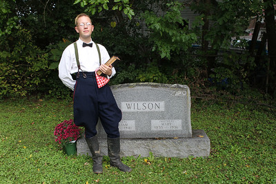Candace H. Johnson-For Shaw Media Maximillian Gambony, 18, of Grayslake portrays William Wilson (1851-1941) as he stands next to his grave during the 22nd annual Living History Tour of the Grayslake Cemetery. Wilson was married to Mary Whitehead who was born on the farm which is now Grayslake's Central Park. The tour was presented by the Grayslake Historical Society. (10/6/19)