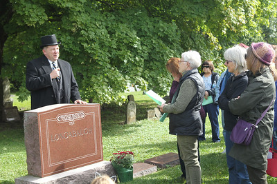 Candace H. Johnson-For Shaw Media Tim Drevline, of Grayslake portrays John J. Longabaugh (1858-1916) as he stands next to his grave and talks about his life in Grayslake with his wife and two sons during the 22nd annual Living History Tour of the Grayslake Cemetery. Longabaugh was one of the signers on a petition asking that Grayslake be incorporated. The tour was presented by the Grayslake Historical Society. (10/6/19)