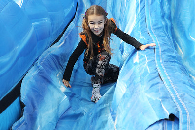 Candace H. Johnson-For Shaw Media Emily Melzer, 7, of Round Lake gets ready to climb out of the inflatable slide she just went down during the Grant Township & Village of Fox Lake Fall Festival at Grant Township Center in Ingleside.  (10/6/19)