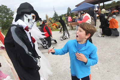 Candace H. Johnson-For Shaw Media Joe Sovsky, 9, of Volo reacts as he sees a skeleton on display during the Grant Township & Village of Fox Lake Fall Festival at Grant Township Center in Ingleside.  (10/6/19)