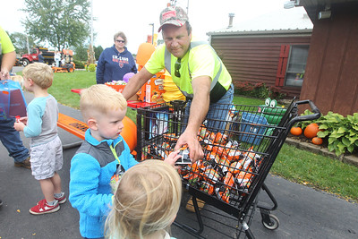 Candace H. Johnson-For Shaw Media Jim Smak, of Ingleside, a foreman with the Grant Township Highway Department, hands out popcorn balls and fruit snacks to children for Touch-A-Truck during the Grant Township & Village of Fox Lake Fall Festival at Grant Township Center in Ingleside.Smak has been with the highway department for thirty-four years.  (10/6/19)