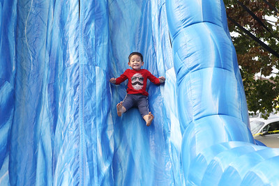Candace H. Johnson-For Shaw Media Peyton Maglangit, 3, of Volo goes down an inflatable slide during the Grant Township & Village of Fox Lake Fall Festival at Grant Township Center in Ingleside.  (10/6/19)