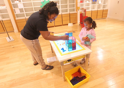 Candace H. Johnson-For Shaw Media Courtnee Bon, of Gurnee works with her daughter, Sabrina, 4, building a tower on a light table in the Light Site area at the Busy Brains Children's Museum Pop Up Museum at Hawthorn Mall in Vernon Hills. The Pop Up Museum will be at Hawthorn Mall until January 5th, 2020. (10/12/19)