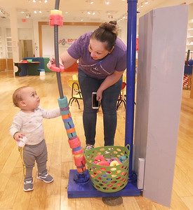 Candace H. Johnson-For Shaw Media Jaxson Poston, eleven-months-old, of Palatine and his mother, Kristi, play with a Spine Vine at the Busy Brains Children's Museum Pop Up Museum at Hawthorn Mall in Vernon Hills. The Pop Up Museum will be at Hawthorn Mall until January 5th, 2020. (10/12/19)