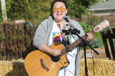 Candace H. Johnson-For Shaw Media Rachel Marie Miller, of Cary sings an original song during the Fox Lake Pumpkin Jubilee at Community Garden Green in Fox Lake. (10/12/19)