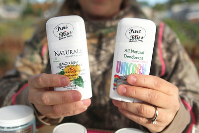 Candace H. Johnson-For Shaw Media Jennifer Gammel, of Lakemoor holds up her big seller, Naturals deodorant from Pure Bliss Artisan Soap, in the Artisan Market during the Fox Lake Pumpkin Jubilee at Community Garden Green in Fox Lake. (10/12/19)