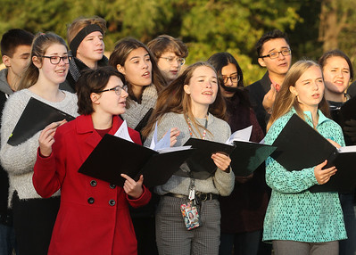 "Candace H. Johnson-For Shaw Media The Chamber Singers from Grant Community High School sing, ""Build Me Up Buttercup,"" during the Fox Lake Pumpkin Jubilee at Community Garden Green in Fox Lake. The Chamber Singers were under the direction of Krista Koske, choir director. (10/12/19)"