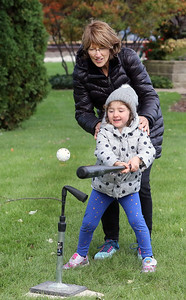 Candace H. Johnson-For Shaw Media Isabella Wadleigh, 4, gets some help from her grandmother, Bonniesue, both of Lake Villa as she takes a swing at the ball during the Village of Lake Villa's Celebration of Fall at Lehmann Park in Lake Villa. (10/12/19)