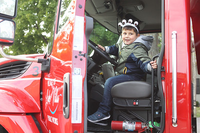 Candace H. Johnson-For Shaw Media Max Styx, 5, of Antioch checks out a Village of Lake Villa Public Works dump truck for Touch-a-Truck during the Village of Lake Villa's Celebration of Fall on Cedar Avenue. (10/12/19)