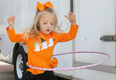 Candace H. Johnson-For Shaw Media Logan Dimeo, 3, of Lake Villa plays with a hula hoop during the Village of Lake Villa's Celebration of Fall on Cedar Avenue in Lake Villa. (10/12/19)