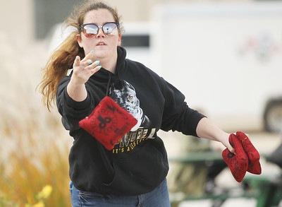 Candace H. Johnson-For Shaw Media Hannah Lawson, 17, of Lindenhurst competes in the Baggo Tournament during the Village of Lake Villa's Celebration of Fall on Cedar Avenue. (10/12/19)
