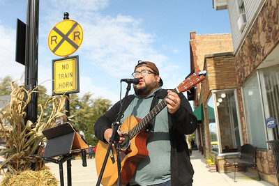 Candace H. Johnson-For Shaw Media Ricky Orta, of Milwaukee, Wis., sings a Bob Seger song on Cedar Avenue during the Village of Lake Villa's Celebration of Fall in Lake Villa. (10/12/19)