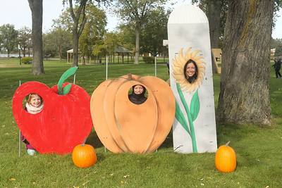 Candace H. Johnson-For Shaw Media Emma Schroeder, 6, of Wadsworth and her brother, James, 8, get their picture taken in a fall scene with their mother, Kaelyn, during the Village of Lake Villa's Celebration of Fall at Lehmann Park in Lake Villa. (10/12/19)