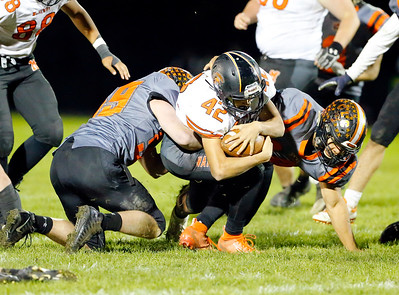 McHenry's Matteo Acosta is tackled as by Crystal Lake Central defenders during their week 8 football game at Crystal Lake Central High School on Friday, Oct. 18, 2019, in Crystal Lake.