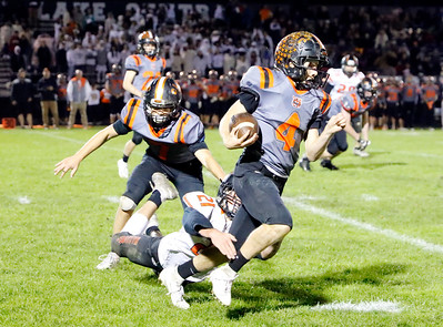 Crystal Lake Central's Jake Coss is tackled by McHenry's Daniel Hallaert during their week 8 football game at Crystal Lake Central High School on Friday, Oct. 18, 2019, in Crystal Lake.