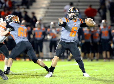 Crystal Lake Central's Aidan Ellinger drops back to pass against McHenry during their week 8 football game at Crystal Lake Central High School on Friday, Oct. 18, 2019, in Crystal Lake.