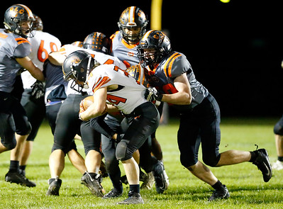 McHenry's Brody Hallin is tackled as he runs the ball against Crystal Lake Central during their week 8 football game at Crystal Lake Central High School on Friday, Oct. 18, 2019, in Crystal Lake.