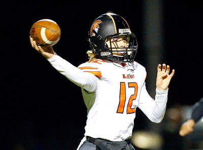McHenry's Andrew Hoffman drops back to pass against Crystal Lake Central during their week 8 football game at Crystal Lake Central High School on Friday, Oct. 18, 2019, in Crystal Lake.