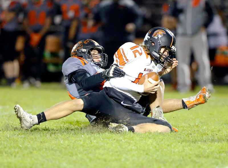 McHenry's Andrew Hoffman is sacked during their week 8 football game at Crystal Lake Central High School on Friday, Oct. 18, 2019, in Crystal Lake.