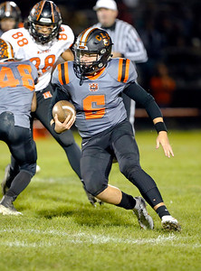 Crystal Lake Central's Aidan Ellinger runs the ball against McHenry during their week 8 football game at Crystal Lake Central High School on Friday, Oct. 18, 2019, in Crystal Lake.