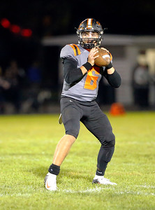 Crystal Lake Central's Aidan Ellinger looks for a pass against McHenry Warriors during their week 8 football game at Crystal Lake Central High School on Friday, Oct. 18, 2019, in Crystal Lake.